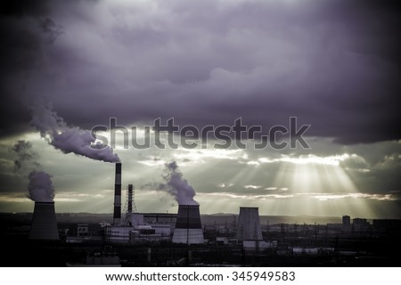 View in thermal power plants. Through the large clouds punched bright sunlight.