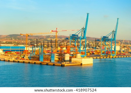 View industrial port at sunet. Civitavecchia, Italy - stock photo