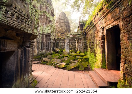 View inside the complex of Ta Prohm temple, Angkor, Cambodia - stock photo