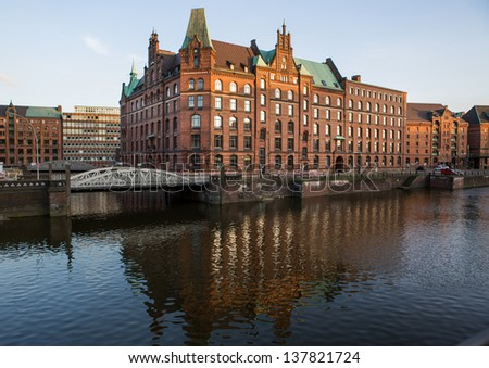 View into a channel at the Speicherstadt, historic warehouse district at Hamburg harbor - stock photo