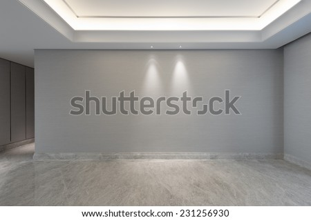 View into an empty living room with walkway