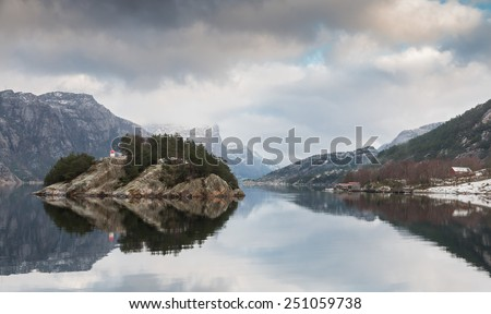 View into beautiful Norwegian Lysefjord on a cold and cloudy winter day - stock photo
