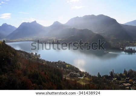 View landscape of blue Annecy lake in France and mountains - stock photo