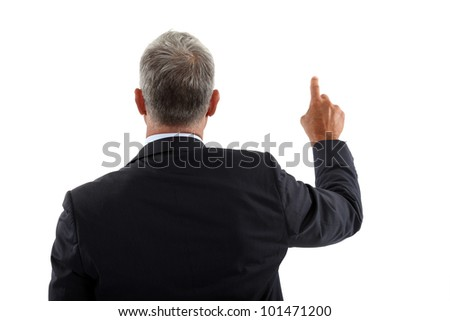 view of a back of a businessman pushing a button