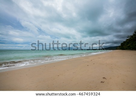 view of a beach before rain storms and sunset in Thailand.