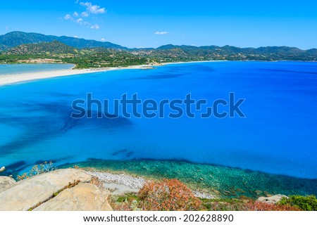 View of a beautiful bay with azure sea  from top of a hill, Villasimius, Sardinia island, Italy - stock photo