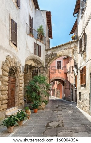 View of a beautiful little street in the old town in Tuscany, Italy - stock photo