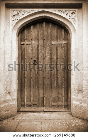 View of a Beautiful Old Oak Door Background in Sepia - stock photo