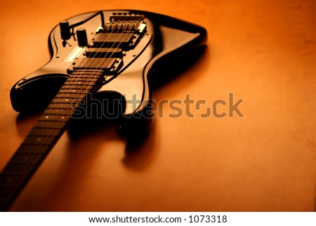 View of a black guitar with copy-space