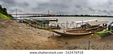 View of a boats pier in the Madre de Dios River, Puerto Maldonado, Peru. - stock photo