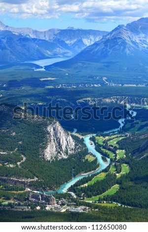 View of a Bow river valley and golf courses against Rocky Mountains. Banff National Park. Alberta. Canada