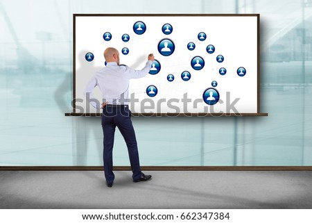 View of a Businessman in front of a wall with a business network connection - business concept