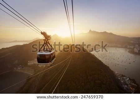 View of a cable car at sunset, showing several beaches and landmarks in Rio de Janeiro.  - stock photo