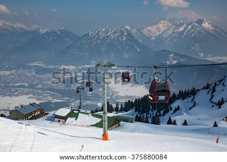 View of a cable car on top of a mountain in Austria. - stock photo