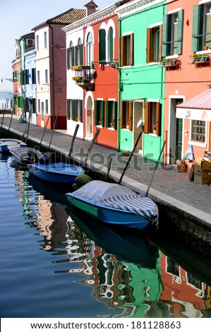 View of a canal in Burano with colorful houses.