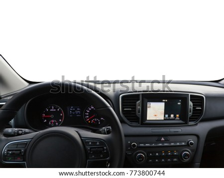View of a car dashboard with a navigation unit. View of the empty windshield for customization.
