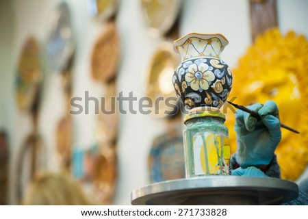 View of a ceramic pot from Caltagirone being decorated by a local artisan - stock photo