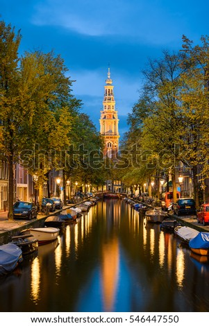 View of a church and a canal in Amsterdam, Netherlands at night