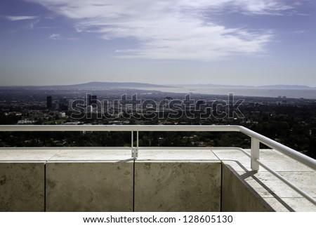view of a city from a balcony - stock photo