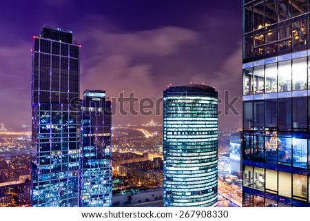 View of a city skyline at dusk with skyscrapers in the foreground. - stock photo