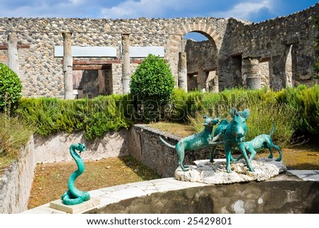 View of a courtyard with bronze statues in Pompeii, Italy - stock photo
