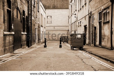 View of a Deserted Dark Inner City Alley - stock photo