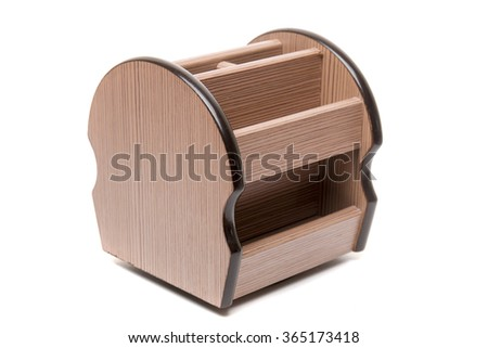 View of a desk organizer for pens, pencils and other objects isolated on a white background. - stock photo