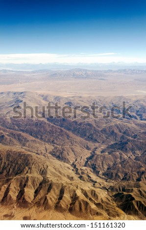 View of a dry desert from an airplane somewhere over South America - stock photo