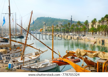 View of a famous Port Vell marina in Barcelona with sailboats in the foreground. Spain