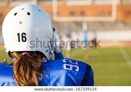 View of a football game from the bench - stock photo
