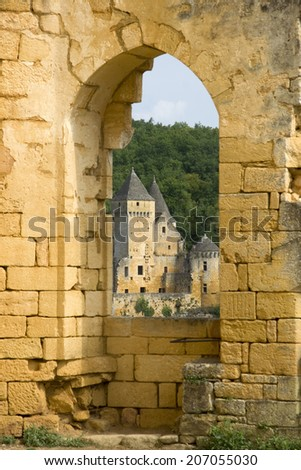 View of a French castle looking through an old brick archway