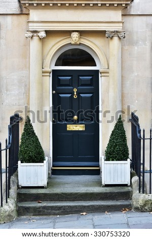 View of a Front Door of a Beautiful English Town House - stock photo