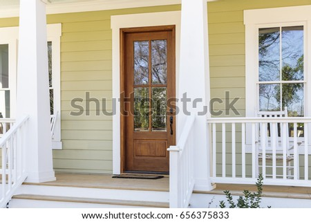 View of a front door of a beautiful house with an inviting entryway.