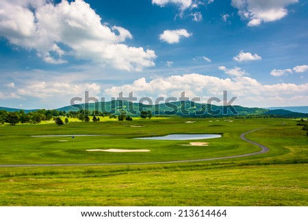 View of a golf course and distant mountains at Canaan Valley State Park, West Virginia. - stock photo