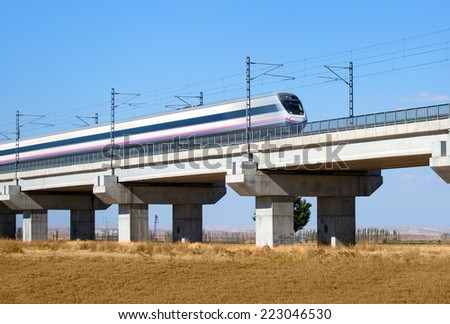 view of a high-speed train crossing a viaduct  - stock photo