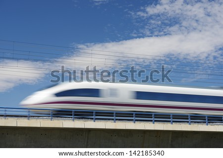 view of a high-speed train crossing a viaduct in El Burgo de Ebro, Saragossa, Aragon, Spain. AVE Madrid Barcelona - stock photo