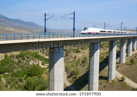 view of a high-speed train crossing a viaduct in Saragossa province, Aragon, Spain, AVE Madrid Barcelona. - stock photo