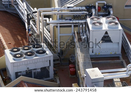 View of a huge group of air conditioning on a roof. - stock photo