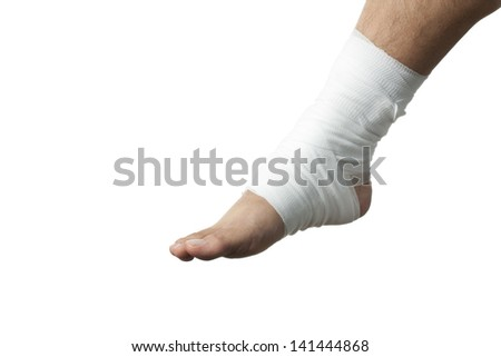 View of a injured ankle wrapped with white medicine bandage isolated on white. - stock photo