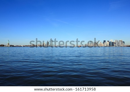 View of a large city along the shoreline of a body of water. - stock photo