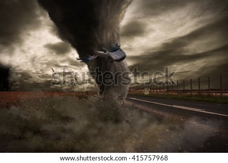 View of a large tornado destroying a road - stock photo