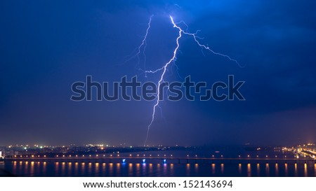 View of a lightning over city at night - stock photo