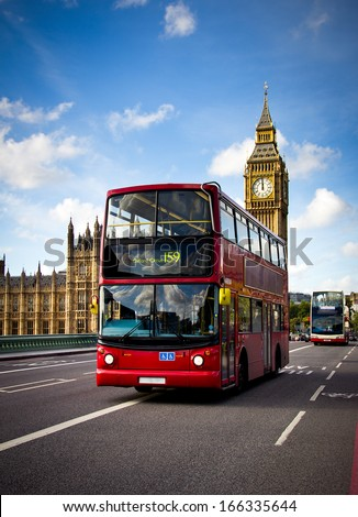 view of a london bus with the big ben in background - stock photo