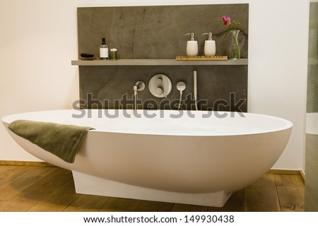 View of a modern bathtub in bathroom at home - stock photo