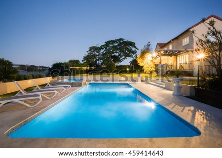 view modern house lights. View Of A Modern House Or Hotel From The Pool Side Corner With Blue Water Illuminated Lights W