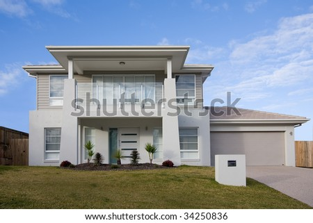 View of a modern two storey house in a contemporary style, with a balcony - stock photo