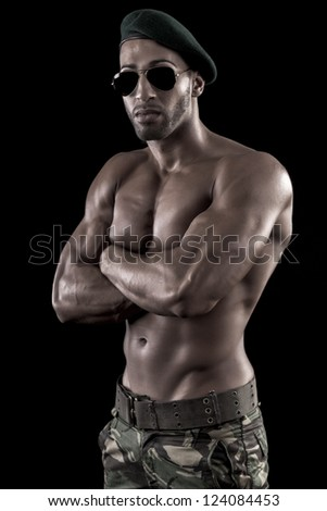 View of a muscled man on a black background in artistic, fitness and bodybuilding poses.