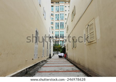 View of a Narrow Deserted Alley - stock photo