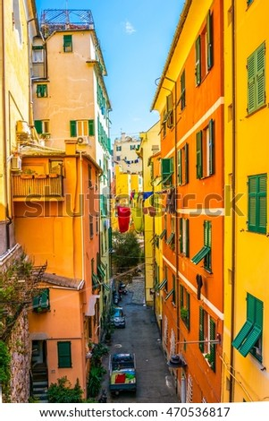 view of a narrow street in the historical center of the italian city genoa.