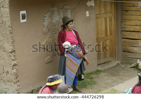 View of a Native peruvian woman and her baby, Paru Paru Community, Andes Mountain. October 22, 2012 - Peru - stock photo